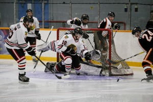 The Hawks McLuckie clears the crease in the 2nd period (D.Mahussier/1812 Photography)